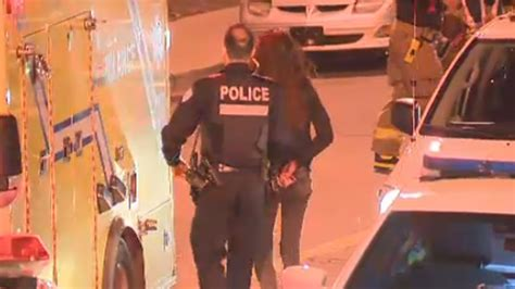 woman arrested handcuffed woman arrested after man shot in hotel hallway ctv