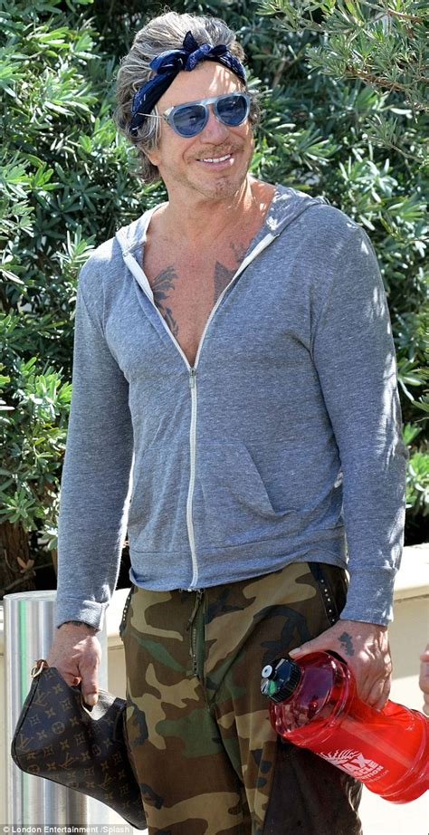 mickey rourke heads to workout in goggle style sunglasses
