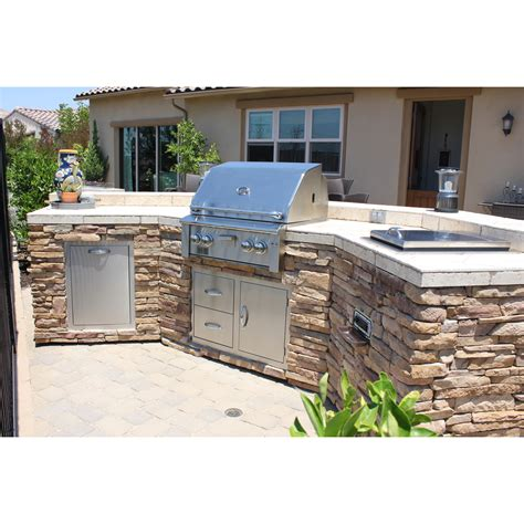 outdoor island kitchen curved bbq island w stacked stone and stereo system