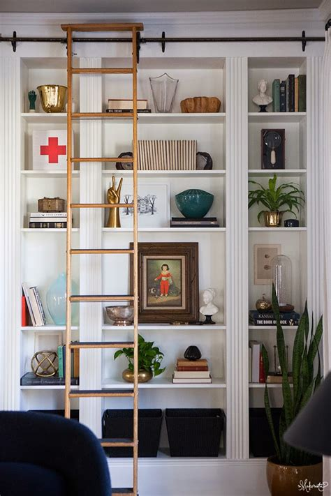 the sliding library ladder gives the built ins an