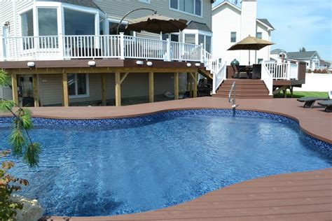 The Deck And Patio Company by The Deck And Patio Company Replaces Pool And Deck After