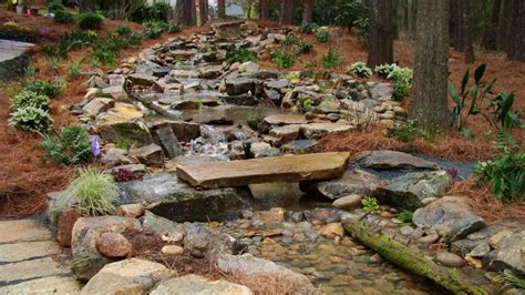 backyard stream man made mountain stream with pond patio fire pit