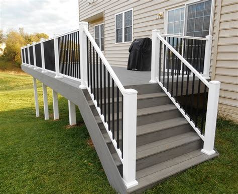 White Deck Railing With Black Balusters Timbertech Deck In Silver Maple And White Vinyl Handrail