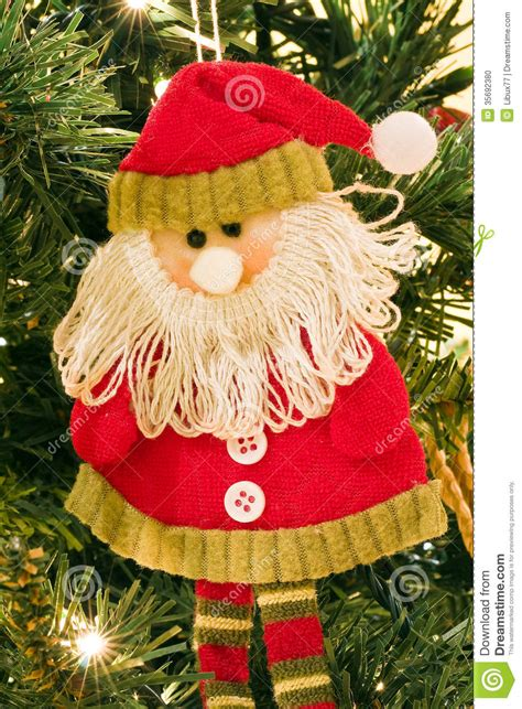 decorative santa claus on christmas tree closeup stock