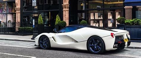 white laferrari gets matching blue wheels and window tint