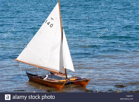 catamaran boat small small catamaran sailing boat on the shore at babbacombe