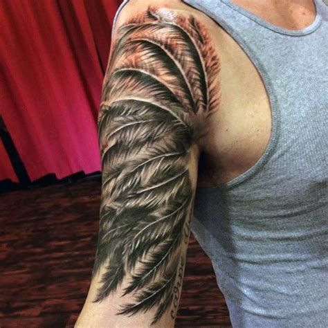 feather tattoos for men 70 feather designs for masculine ink ideas