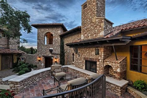 cornerstone architects brick and stone mediterranean estate with lovely patio