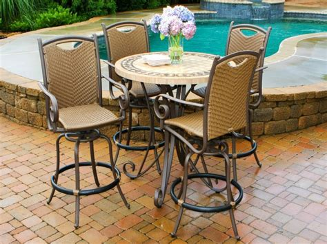 High Top Round Patio Table And Four Metal Swivel Chairs