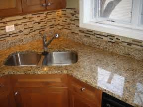 giallo ornamental granite countertop and matching glass