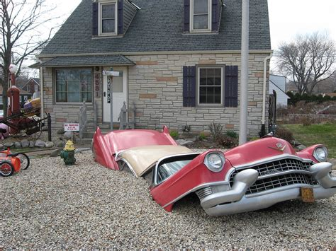 the car is in the front yard cadillac fleetwood car buried in cudahy wisconsin yard
