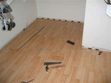 can i install laminate wood flooring over linoleum alyssamyers