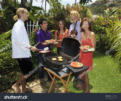 backyard bar b que friends at a backyard bar b que in hawaii stock photo