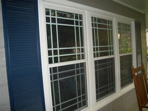 how to put a house window back on track grids or no grids for windows atlanta home improvement