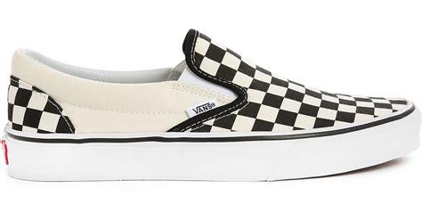 vans black and white check slip ons in white for lyst