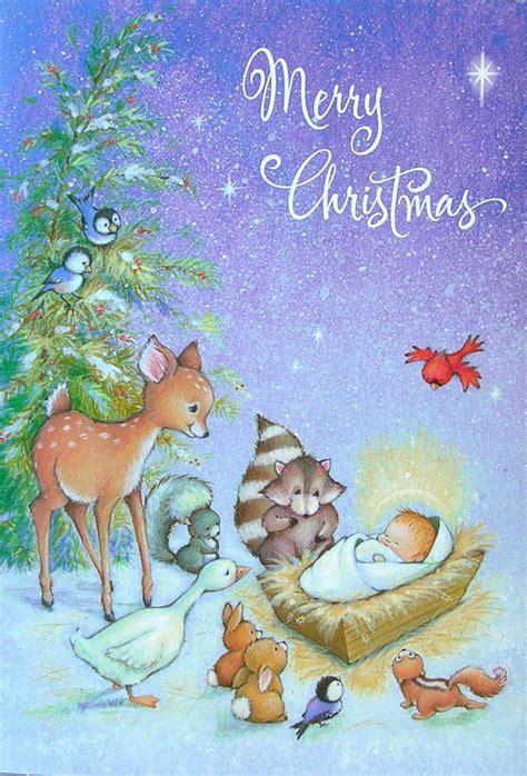 animal nativity scene baby jesus deer raccoon bunny bird christmas greeting card christmas