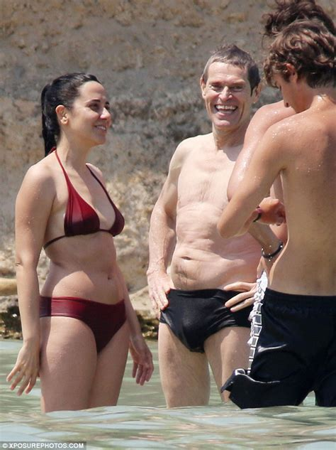 Shirtless Willem Dafoe relaxes on beach with his wife Giada Colagrande in Italy   Daily Mail Online