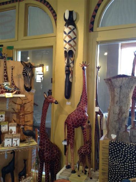 fair trade home decor giraffe wood carvings and fang mask fair trade african