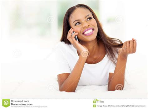 woman talking on cell phone in bed stock image f006 6900 african woman talking phone royalty free stock photo