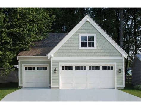 three car garage white carriage house style garage doors on a detached