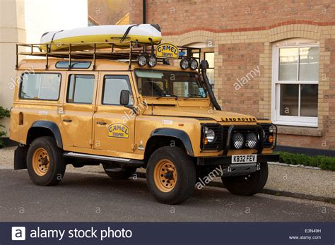 rugged road vehicles a camel trophy land rover defender contrasts the rugged road stock photo royalty free