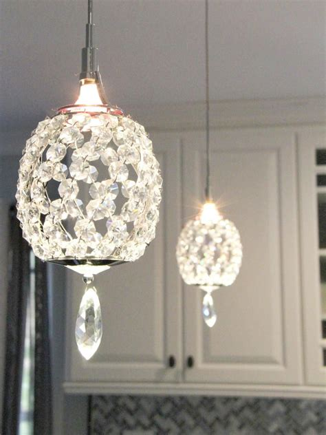 Pendant Lighting With Crystals Pendant Lights A Peninsula Bring A Touch Of Glam To This Transitional Kitchen