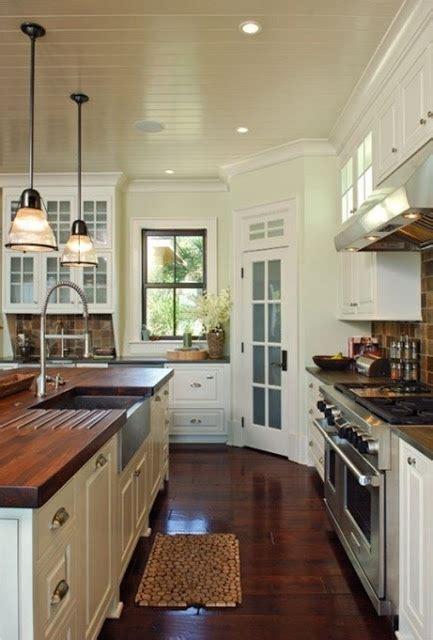 dark stained wood floors  butcher block countertops