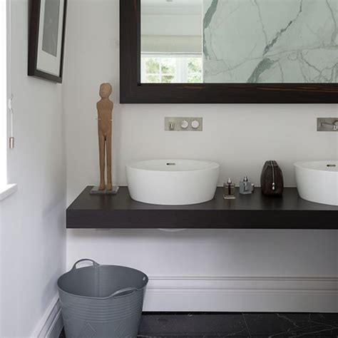 white bathroom with black countertop decorating