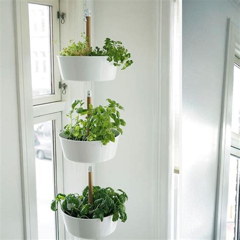 White Hanging Planters by Bittergurka Hanging Planter White Cooking Pot For