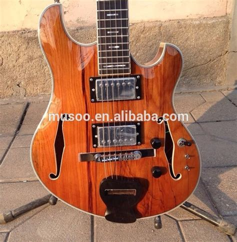 S X Supply Co Brand musoo brand electric guitar with maple top semi