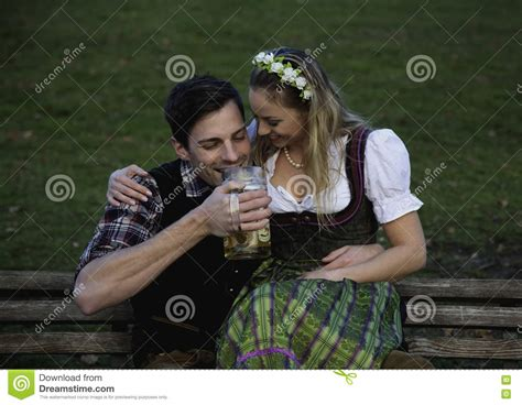 bench drinking bavarian couple with beer stock photo image 80673080