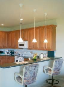 ordinary Contemporary Mini Pendant Lighting Kitchen #1: low-hanging-mini-pendant-lights-over-kitchen-island-for-an-apartment.jpg?x34469