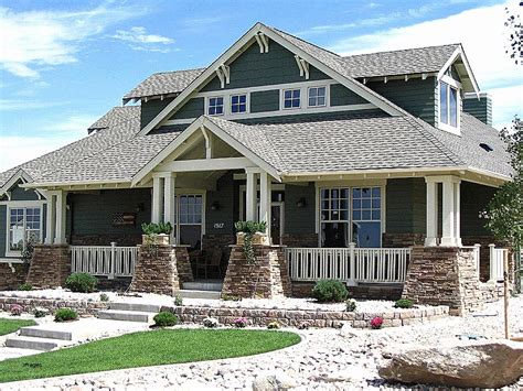 brick home plans with wrap around porch design