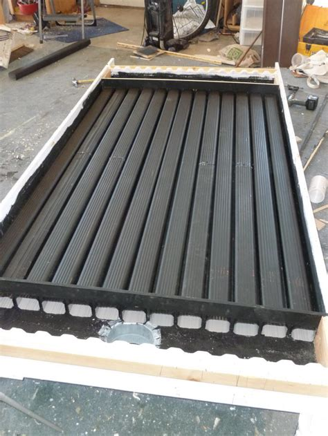 Aluminum Screen Solar Furnace - pop can and downspout solar air heating collector flow