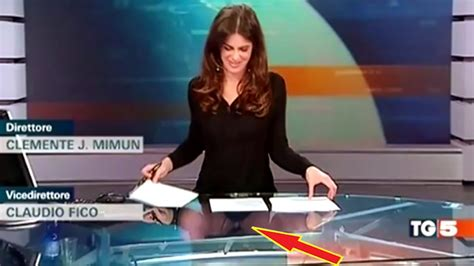 claudio fico glass desk presenter forgets she s sitting at a glass desk and