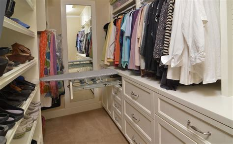 Closet Ironing Board by Ironing Board Cabinet Extensions For Organized Laundry Rooms