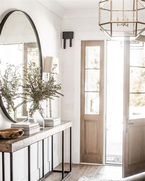farmhouse entryway  large mirror rustic console table