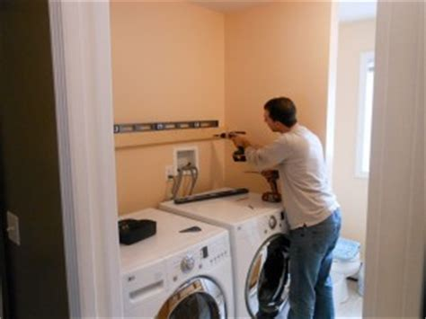 how to hang laundry room cabinets 187 tips for hanging wall cabinets