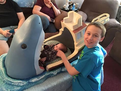 baby shark jaws sculptor makes horrifyingly cute jaws themed crib for his