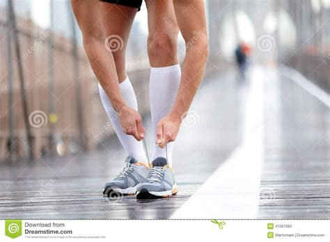 athlete s foot shoes running shoes runner tying laces new york stock