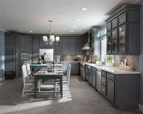 maple kitchen island legs maple in greyloft with a contrasting cabinet back in soothing aegean lifts the spirits in