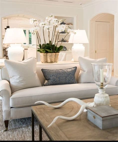 neutral sofa decorating ideas how to get a high end look on a budget confettistyle
