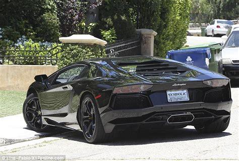 Kim Kardashian takes delivery of a sleek Lamborghini
