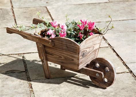 Decorative Wooden Wheelbarrow Planter by Decorative Wooden Wheelbarrow Planter H27cm X L62cm 163 12 99