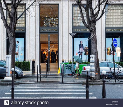 sophisticated luxury displayed by avenue montaigne louis vuitton store entrance and display windows on avenue