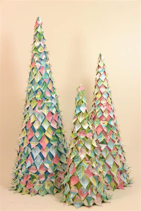 newspaper cone christmas trees paper mache cone scrap paper cut into diamonds some glitter acrylic spray and glue