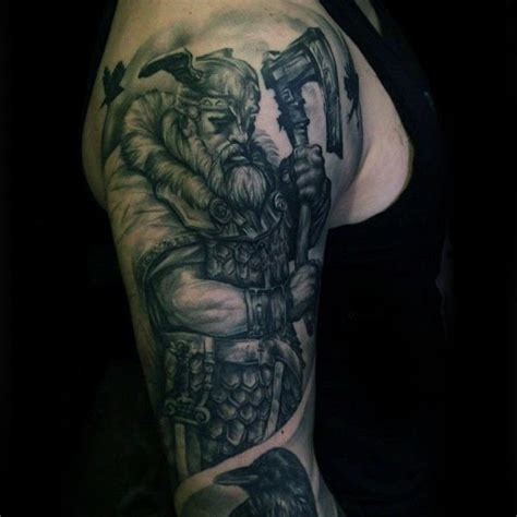 tattoo pictures of viking warriors cool viking warrior with axe guys arm tattoo design ideas