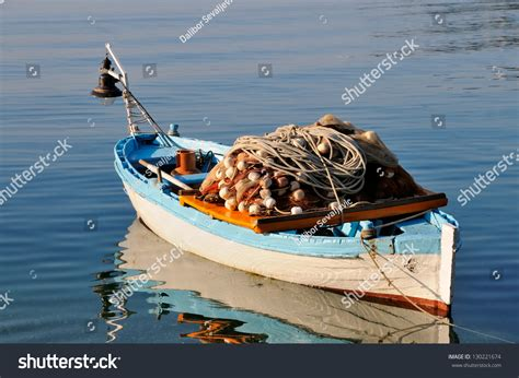 fishing boat equipment small fishing boat with fishing net and equipment stock