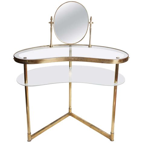 unique brass glass vanity table with shelf and spinning