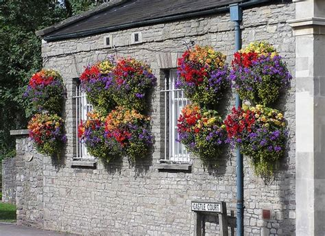 Outdoor Hanging Flower Baskets And Pots A Guide To Planting Garden Wall Hanging Baskets